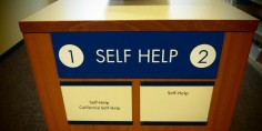 Bookshelves labeled Self Help
