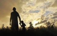 Man and boy in silhouette.