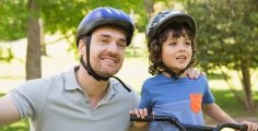 Father and kid on bike.