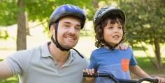 Father and kid on bike.